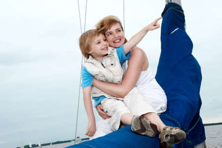 Happy family onboard the yacht. A vacation photo