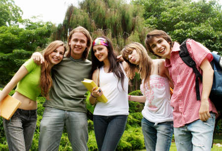 Portrait happy young students in park Stock Photo - 6223828