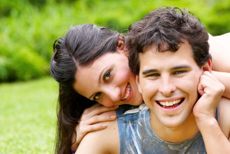 Portrait of young, happy couple against the nature Stock Photo - 6222266