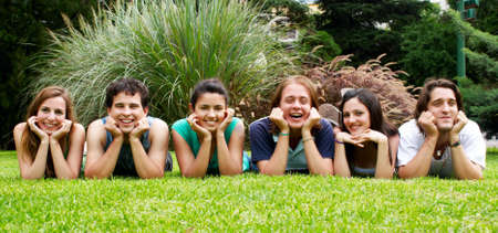 happy group of friends smiling outdoors in a park Stock Photo - 6222179