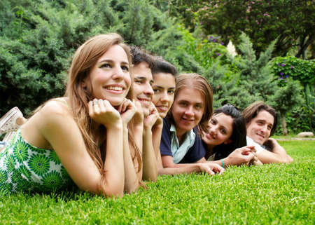 happy group of friends smiling outdoors in a park Stock Photo - 6222312