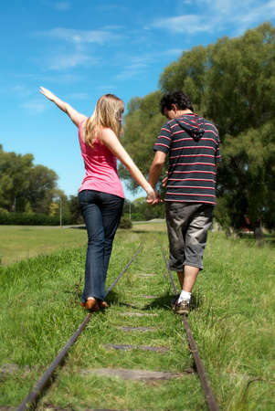young couples going along a railroad line photo