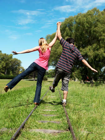 young couples going along a railroad line