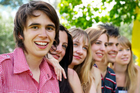 Portrait of a beautiful young guy and friends group photo