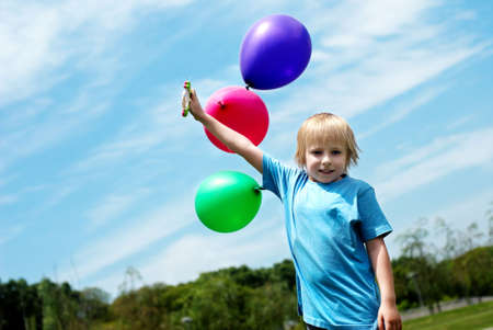 The little boy with balloons photo