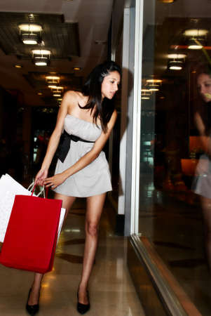 prestigious: The beautiful young girl in prestigious shop Stock Photo
