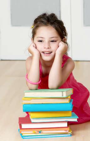 Portrait preschooler with book in kindergarten