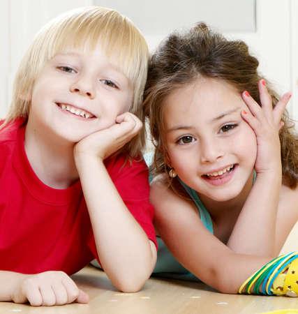 Portrait happy kids on light background photo