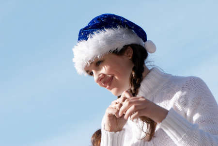 The girl in a New Year's cap against sky Stock Photo - 7953134