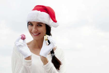 Mrs. Santa with a gift box. Stock Photo - 7953108
