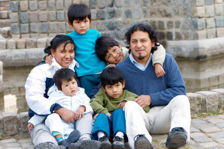 bolivian: Happy Latin family sitting in the street