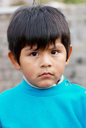 Little boy portrait at the street photo