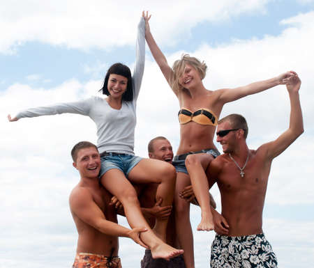 Group of friends having fun at the beach  photo