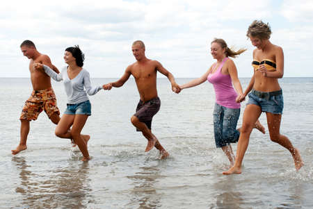 Group of friends having fun at the beach Stock Photo - 7953342