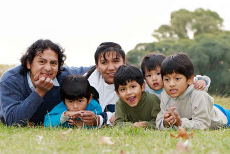 poor woman: Happy Latin family  in the park