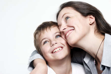 blonde mom: Happy mother with the son isolated on light background