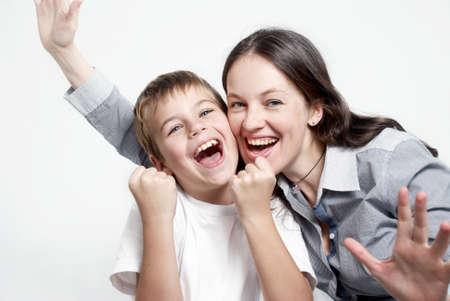Portrait happy family football fans on light background photo
