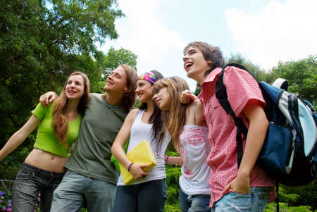 happy young students in park Stock Photo - 8143155