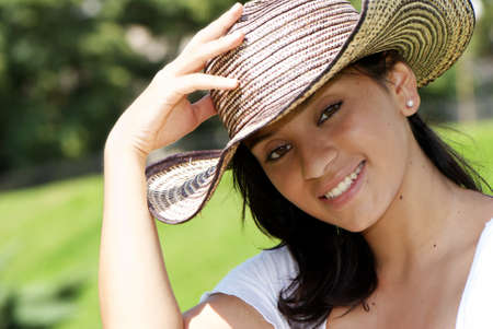 openly: The beautiful Colombian girl in a hat