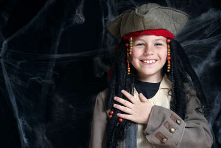 Little boy wearing pirate costume photo