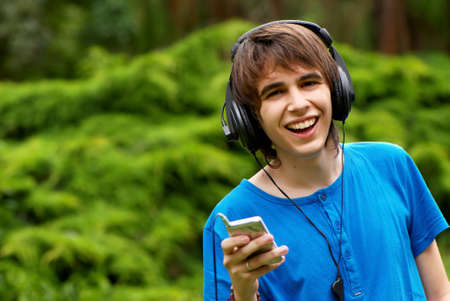 happy teenage boy in headphones photo