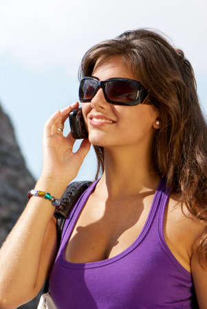 Portrait of the girl in sunglasses and mobile phone photo