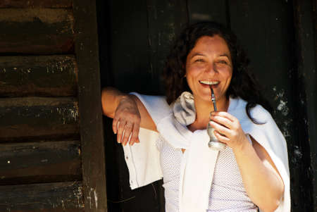Portrait of the Latin American woman drinking a mate Stock Photo