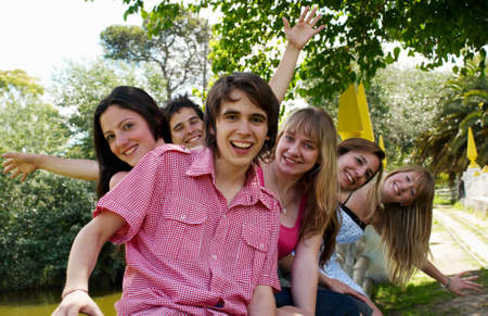 happy group of friends smiling outdoors in a park Stock Photo - 8319151