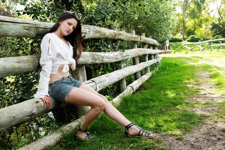 portrait of beautiful latin woman in park photo
