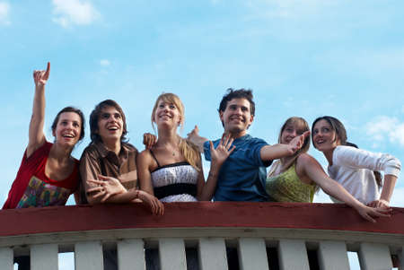 happy group of friends smiling outdoors Stock Photo