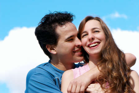 Happy young couple against the sky Stock Photo - 10631737