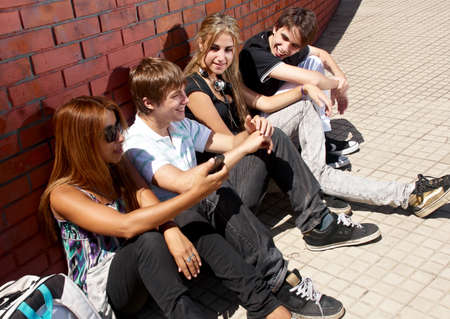 Teenagers Sitting by a street Stock Photo - 10695511