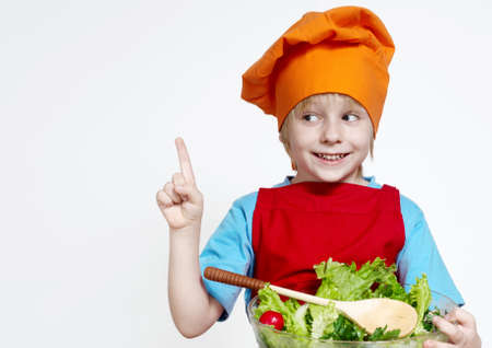 toque: Portrait of the small cook on a light background