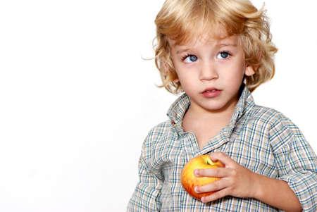 Portrait of the little boy on a light background