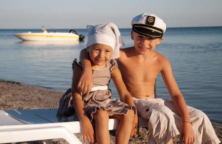 bandana girl: Small happy couple on seacoast Stock Photo