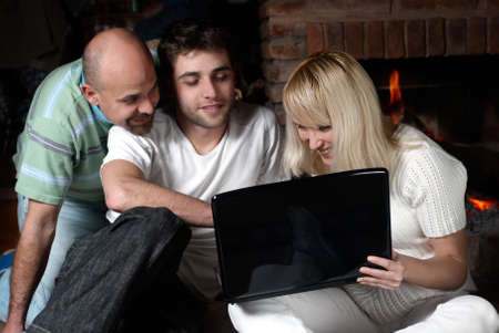 Happy family with laptop in quiet, house conditions photo