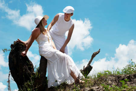 harmonous: Portrait of young, happy couple against the nature  Stock Photo