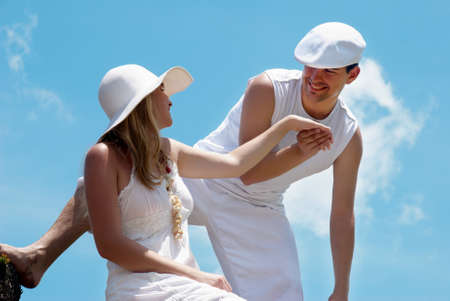 harmonous: Portrait of young, happy couple against the sky