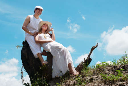 barefoot teens: Portrait of young, happy couple against the nature  Stock Photo