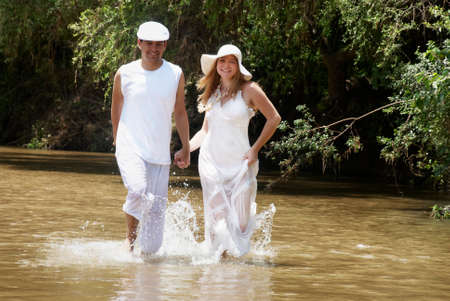 harmonous: Young, happy couple against the nature