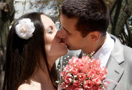 Enamoured newly-married couple photo