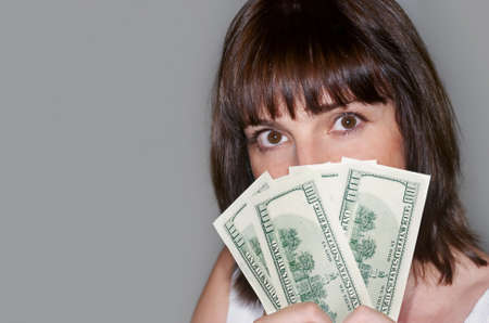 Portrait of  woman holding money in the hand photo
