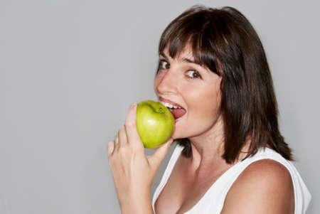 Portrait of young beauty woman with green apple isolated photo