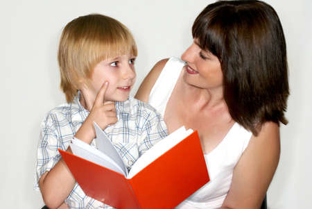 Mother with the son reading the book photo