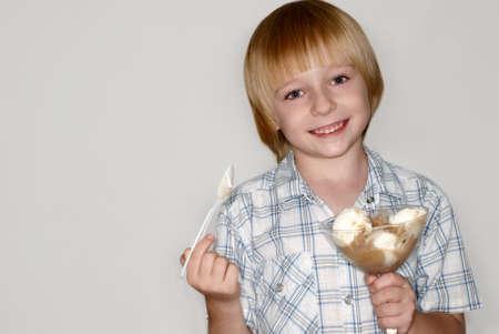 naughty boy: Child eats ice-cream Stock Photo