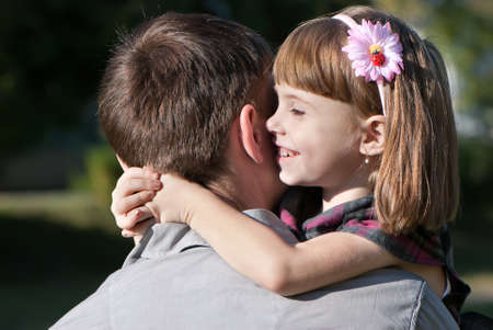 beautiful little girl hugging embracing her father  Stock Photo