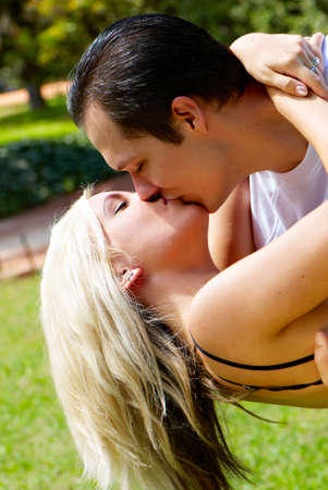 Portrait of kissing couple against the nature Stock Photo - 12137044