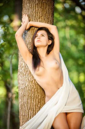 naked woman  white background: Graceful nude female with white silk shawl outdoors