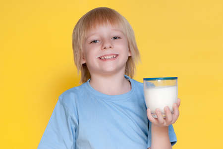 Little boy drinking milk photo