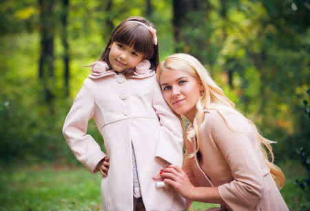 outsides: happy young mother with the daughter in park